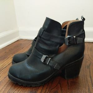 Belted ankle boots
